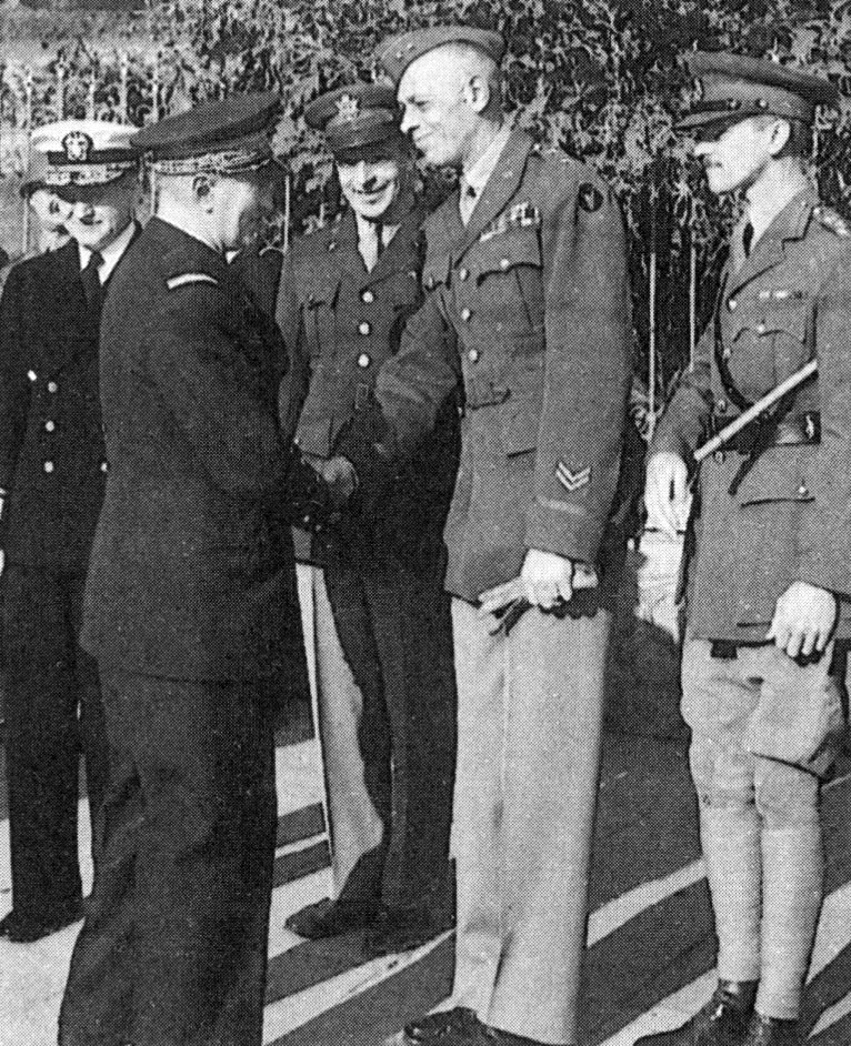 Darlan shaking hands with Major General Charles W. Ryder