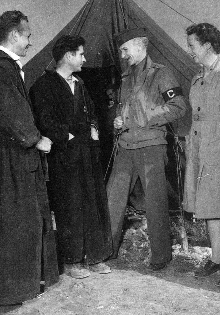 Correspondent Ernie Pyle, slender as a thread at one hundred pounds and given to drink and melancholy, arrived in North Africa with a typewriter to educate America about the war. Here he is seen with wounded soldiers at a hospital near St. Cloud, Algeria, in early December 1942.