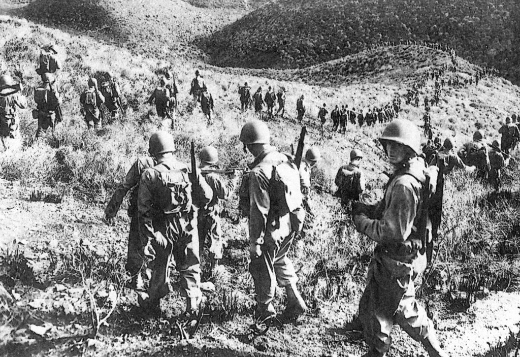 The 1st Ranger Battalion marching over hilly Algerian terrain in late January 1943.