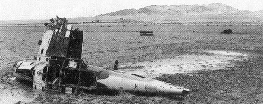 The wreckage of an American P-38 fighter near Sidi bou Zid. In the distance looms Djebel Lessouda, where John Waters was captured and Robert Moore escaped with part of his battalion.