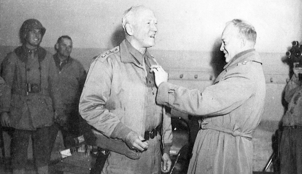 On March 16, 1943, on the eve of the II Corps attack on Gafsa, Eisenhower pins a third star on buoyant Patton to mark his promotion to lieutenant general.