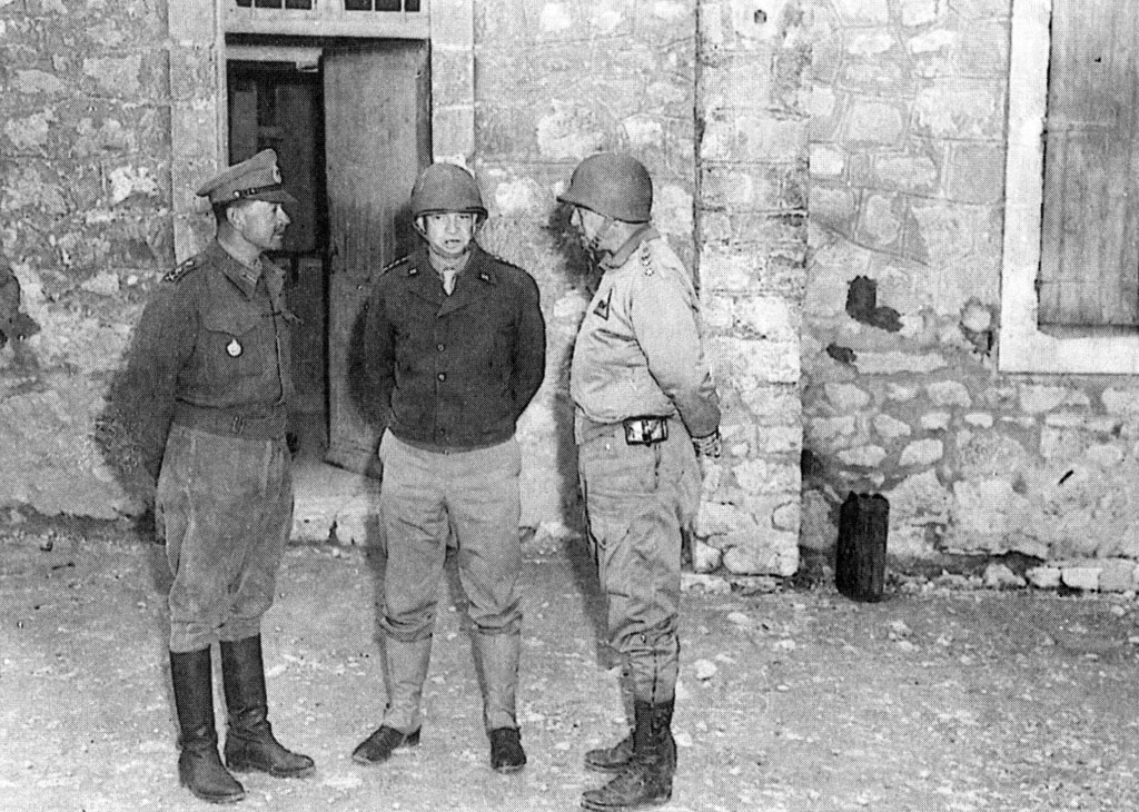 Field Marshal Harold Alexander (left), commander of the new 18th Army Group, with Eisenhower (center) and Patton during their first collective meeting, in Feriana, on March 17, 1943, the day the American attack began on Gafsa and El Guettar.
