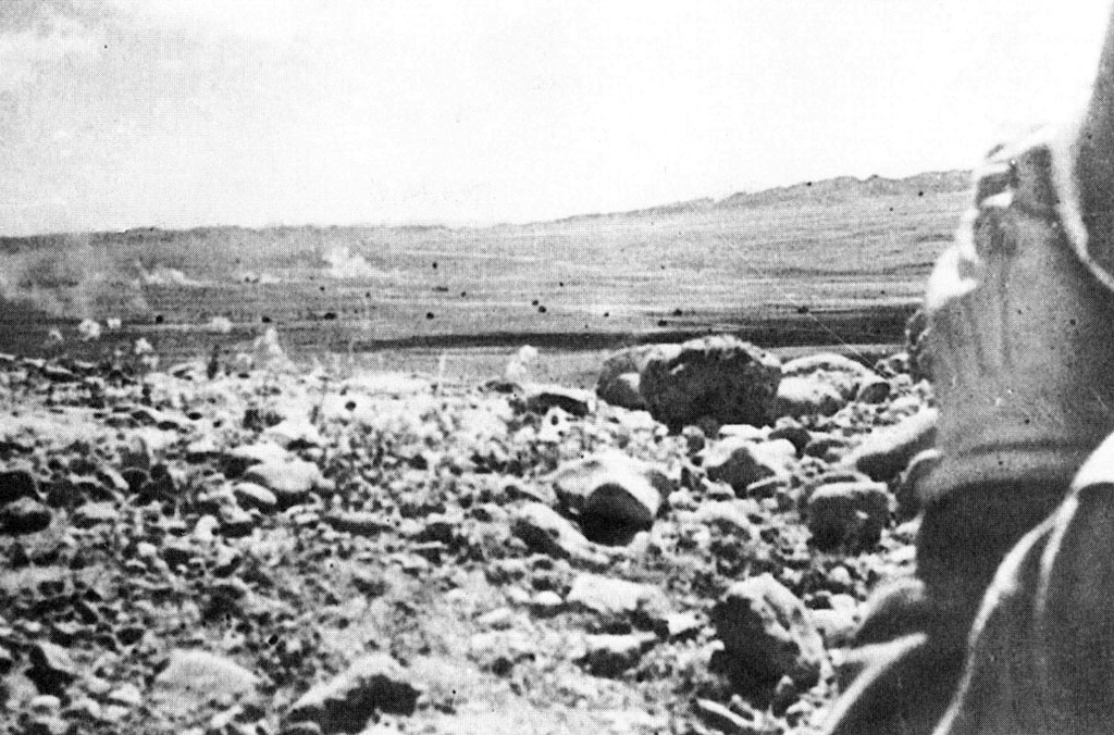 American artillery detonates around attacking German tanks of the 10th Panzer Division near El Guettar on April 23, 1943.