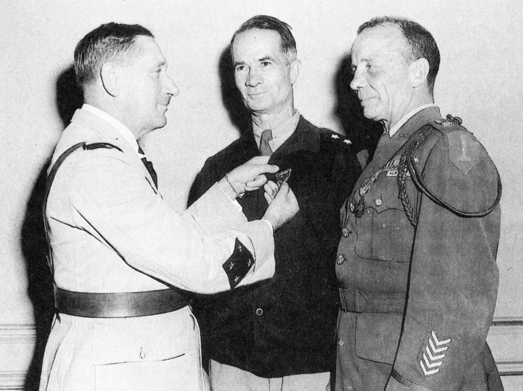 General Louis-Marie Koeltz, commander of the French XIX Xorps, presents the Croix de Guerre to Terry Allen (center) and Ted Roosevelt for their valor in the Tunisian campaign.