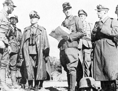 Field Marshal Erwin Rommel (third from left) and his staff in Tunisia in early 1943, from captured German photo negatives.