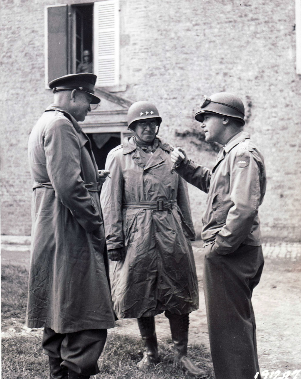 Eisenhower and Bradley listen to Major General J. Lawton Collins, right, commander of the U.S. VII Corps, shortly after the capture of Cherbourg.