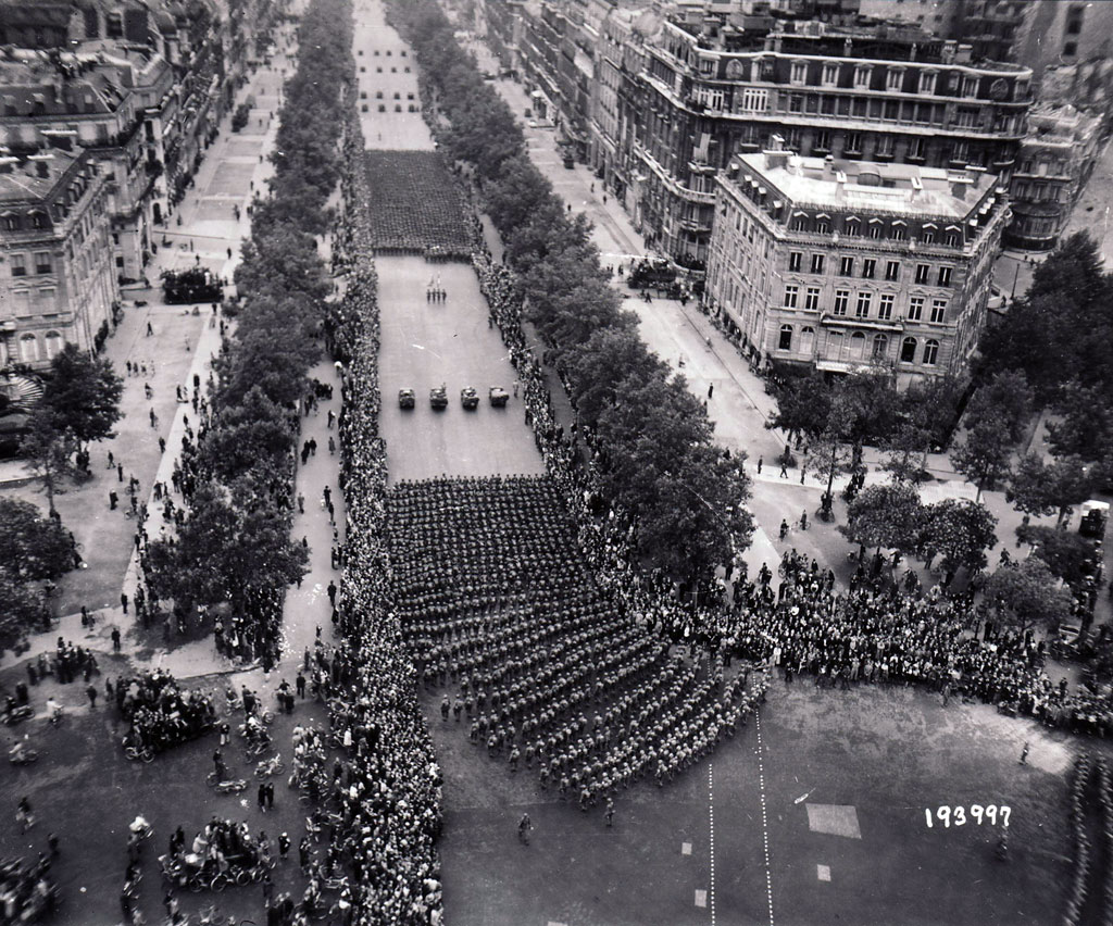 Parisians line the Champs Elysees on August 29 to cheer the U.S. 28th Infantry Division, marching through Paris before taking up pursuit of the German army to the east.