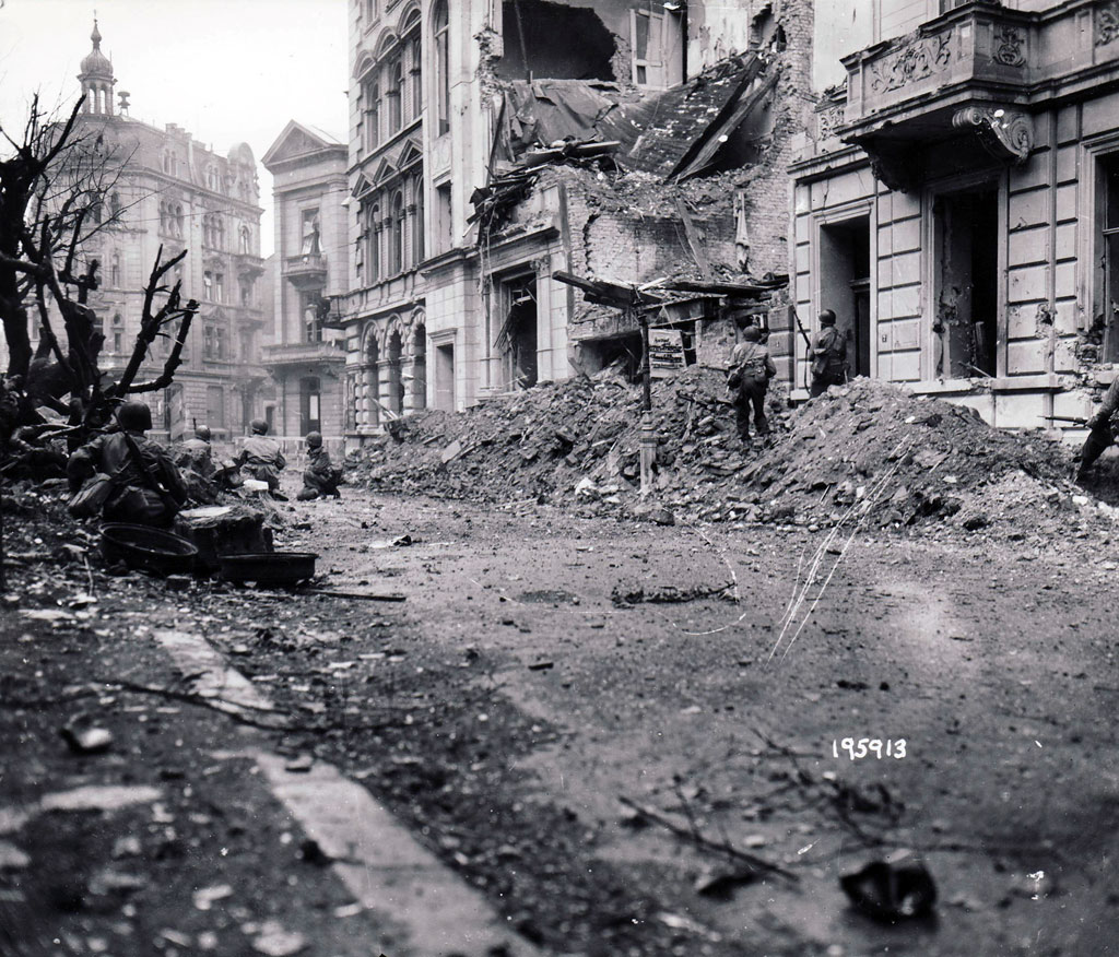 GIs from the 1st Infantry Division battle through central Aachen on October 17, 1944, a day before German defenders finally capitulated.
