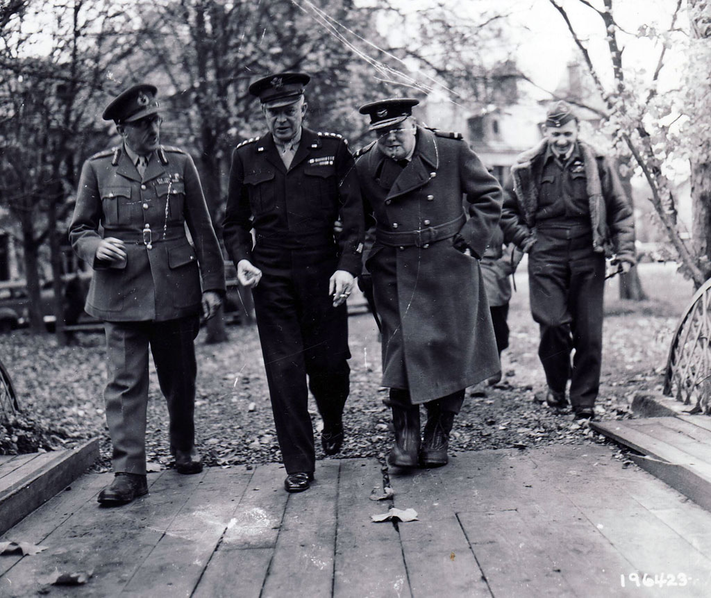 The high command contemplates a winter campaign in northern Europe. Conferring in mid-November at the supreme commander's forward headquarters in Reims are, left to right, Field Marshal Sir Alan Brooke, chief of the Imperial General Staff; Eisenhower; Prime Minister Winston S. Churchill; Tedder.