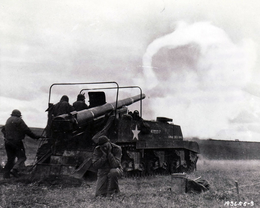 "A self-propelled 155mm ""Long Tom"" pounds enemy targets to the east. After overcoming ammunition shortages early in the summer and fall of 1944, American gunners by early 1945 often fired ten shells or more for every one fired by the enemy."