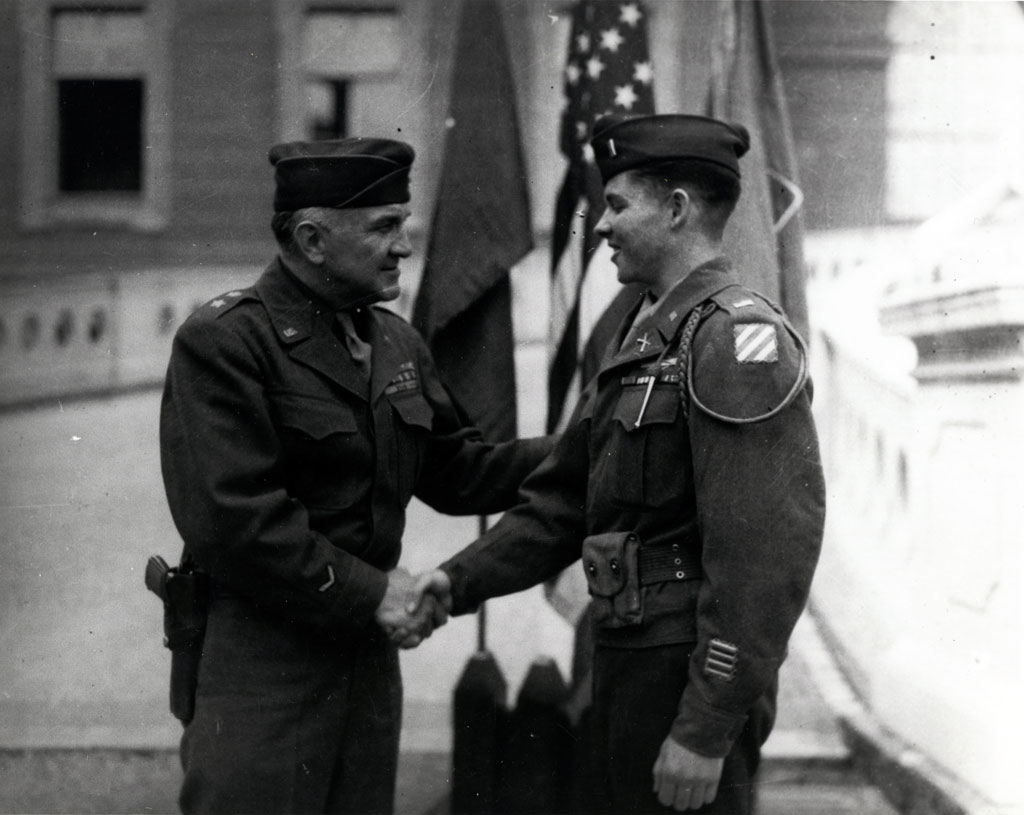 "Lieutenant Audie Murphy, right, is congratulated by Major General John W. ""Iron Mike"" O'Daniel"