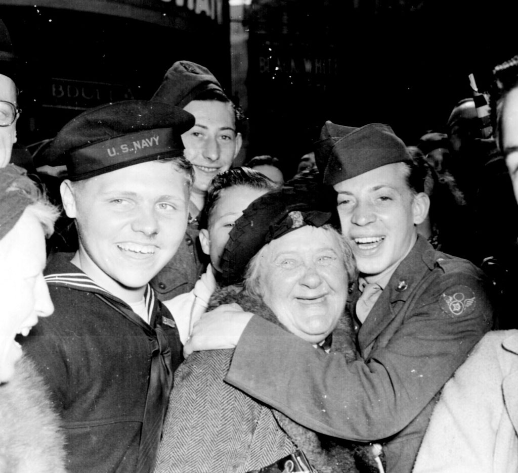 On the night of May 7, hours before the official end of the war in Europe, jubilant Americans celebrate with the British at Piccadilly in central London.