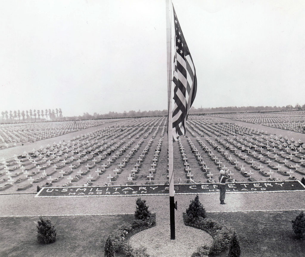 A bugler blows Taps at the close of Memorial Day ceremonies in May 1945 at the U.S. military cemetery at Margraten, Holland.